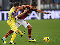 Calcio, Serie A: Roma vs ChievoVerona. Roma, stadio Olimpico, 31 ottobre 2013.<br /> AS Roma midfielder Kevin Strootman, of the Netherlands, is challenged by ChievoVerona midfielder Perparim Hetemaj, of Finland, left, during the Italian Serie A football match between AS Roma and ChievoVerona at Rome's Olympic stadium, 31 October 2013.<br /> UPDATE IMAGES PRESS/Riccardo De Luca