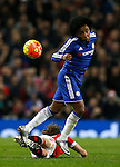 Willian of Chelsea beats Daley Blind of Manchester United to the ball - English Premier League - Manchester Utd vs Chelsea - Old Trafford Stadium - Manchester - England - 28th December 2015 - Picture Simon Bellis/Sportimage
