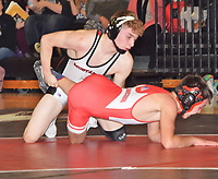 RICK PECK/SPECIAL TO MCDONALD COUNTY PRESS<br /> Defending state champion Oscar Ortiz clinched McDonald County's 45-36 win over Carl Junction on Jan. 31 at MCHS with a pin over Carl Junction's Silas Walker.