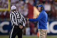 December 7, 2013  (Charlotte, North Carolina)  Duke Blue Devils head coach David Cutcliffe argues a call with referee David Epperley.  (Photo by Don Baxter/Media Images International)