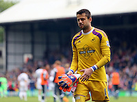 Pictured: Swansea goalkeeper Lukasz Fabianski trhows his gloves and shirt to away supporters<br />