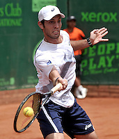 BOGOTA - COLOMBIA -05 -11-2013: Guilherme Clezar, tenista de Brasil  devuelve la bola a Diego Schwartzman, tenista de Argentina, durante partido de la primera ronda del Seguros Bolivar Open en el Club Campestre el Rancho de la ciudad de Bogota. / Guilherme Clezar, Brazil tennis player returns the ball to Diego Schwartzman Argentina tennis player during a match for the first round of the Seguros Bolivar Open in the Club Campestre El Rancho in Bogota city.Photo: VizzorImage  / Luis Ramirez / Staff.