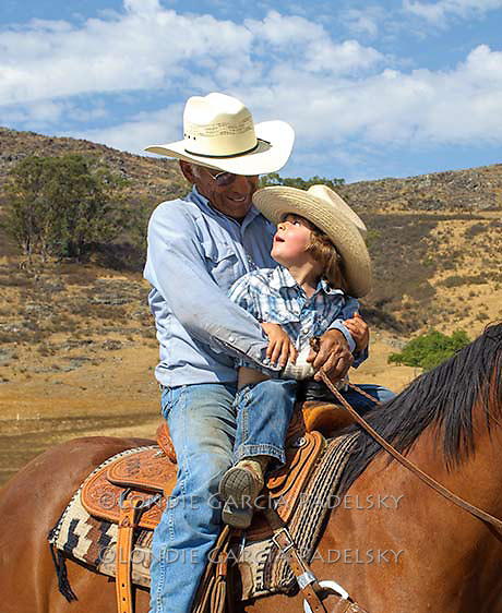 Grandpa Roy shares the saddle with his grandson. San Luis Obispo, California