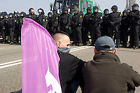 Activists confront riot Police who were blocking the Europe bridge in Stasbourg during the NATO summit. German riot Police were stopping marchers from getting to Germany. Barricades were built by the protesters and set on fire. A border control point was also set on fire.