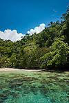 Idyllic beach in Namatota Strait, near Kaimana, Papua.