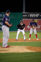 Batavia Muckdogs second baseman Jack Strunc (47) leads off in front of shortstop Antoni Flores (right) as pitcher Jeremy Bleich (48) checks during a NY-Penn League game against the Lowell Spinners on July 10, 2019 at Dwyer Stadium in Batavia, New York.  Batavia defeated Lowell 8-6.  (Mike Janes/Four Seam Images)