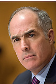 """United States Senator Bob Casey, Jr. (Democrat of Pennsylvania) listens as John Koskinen, Commissioner, Internal Revenue Service, testifies before the United States Senate Committee on Finance on """"IRS Operations and the President's Budget for Fiscal Year 2016"""" in Washington, D.C. on Tuesday, February 3, 2015.  During his testimony, Koskinen said """"In regard to software, we still have applications that were running when John F. Kennedy was President.""""<br /> Credit: Ron Sachs / CNP"""