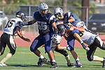 Torrance, CA 09/05/13 - Kila Smith  (North #55), Jack Grimes (Peninsula #4), Luke Megginson (Peninsula #78) and unidentified Peninsula player(s) in action during the Peninsula vs North Junior Varsity football game played at North High School in Torrance, California.