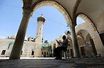 A Palestinian man reads the Koran, Islam's holiest book, at a mosque in Gaza City on the Muslim holy month of Ramadan, on May 21, 2018. Ramadan is sacred to Muslims because it is during that month that tradition says the Koran was revealed to the Prophet Mohammed. The fast is one of the five main religious obligations under Islam. Muslims around the world will mark the month, during which believers abstain from eating, drinking, smoking and having sex from dawn until sunset. Photo by Ashraf Amra