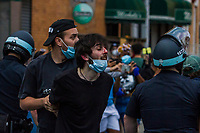 NEW YORK, NEW YORK - MAY 30: A protester is captured during the protest in response to the police officer who killed George Floyd in Brooklyn on May 30, 2020 in New York. The protests spread across the country in at least 30 cities in the United States. United States For the death of unarmed black man George Floyd at the hands of a police officer, this is the latest death in a series of police deaths of black Americans (Photo by Pablo Monsalve / VIEWpress via Getty Images)