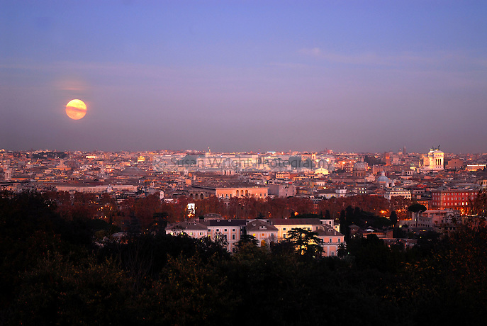Rome skyline at twilight with rising moon, Rome, Italy