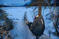 Jim Lanier drops onto the South Fork of the Kuskokwim at the Rohn checkpoint on his way to Nikolai during Iditarod 2009