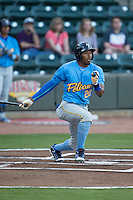 Rashad Crawford (20) of the Myrtle Beach Pelicans follows through on his swing against the Winston-Salem Dash at BB&T Ballpark on April 18, 2016 in Winston-Salem, North Carolina.  The Pelicans defeated the Dash 6-4.  (Brian Westerholt/Four Seam Images)