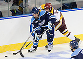 Brice O'Connor (Maine - 16), Travis Oleksuk (Duluth - 11) - The University of Minnesota Duluth Bulldogs defeated the University of Maine Black Bears 5-2 in their NCAA Northeast semifinal on Saturday, March 24, 2012, at the DCU Center in Worcester, Massachusetts.