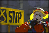 Sqaueak the clown/street entertainer who performs on Union Street, Aberdeen takes her own view on the election campaign as Alex Salmonds Battle Bus rolled in to the city... Pic Donald MacLeod