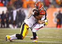 Ryan Shazier #50 of the Pittsburgh Steelers tackles Giovani Bernard #25 of the Cincinnati Bengals in the first half during the Wild Card playoff game at Paul Brown Stadium on January 9, 2016 in Cincinnati, Ohio. (Photo by Jared Wickerham/DKPittsburghSports)
