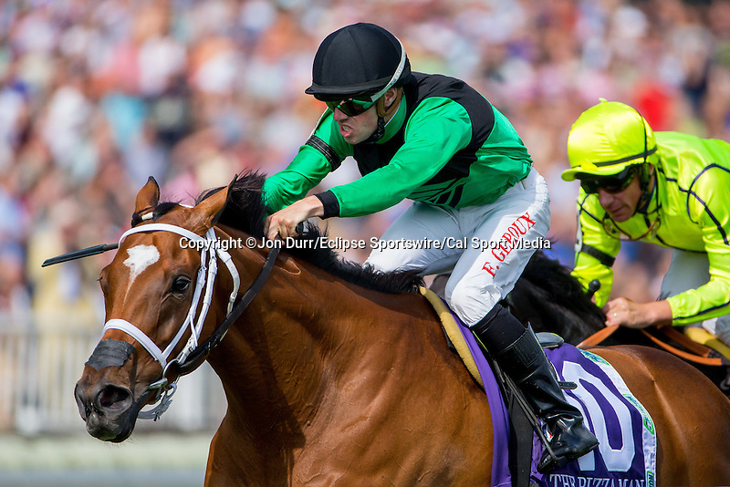 AUG 16, 2014: The Pizza Man, ridden by Florent Geroux, leads the field in the final stretch of the third running of the American St. Leger at Arlington International Race Track in Arlington Heights, IL. Jon Durr/ESW/Cal Sport Media