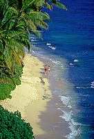 Couple walking along Diamond Head beach