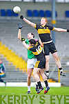 Man of Steel Johnny Buckley rises over Legion's Padraig Lucey in the O'Donoghue cup final in Fitzgerald Stadium on Sunday