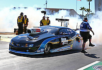 Mar 14, 2014; Gainesville, FL, USA; A crew member for NHRA pro stock driver Chris McGaha during qualifying for the Gatornationals at Gainesville Raceway Mandatory Credit: Mark J. Rebilas-USA TODAY Sports
