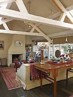 The massive beams in the living room have been limewashed creating a light and airy atmosphere