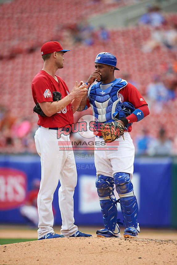 Buffalo Bisons starting pitcher Chris Leroux (28) talks with catcher Wilkin Castillo (32) during a game against the Scranton/Wilkes-Barre RailRiders on July 2, 2016 at Coca-Cola Field in Buffalo, New York.  Scranton defeated Buffalo 5-1.  (Mike Janes/Four Seam Images)