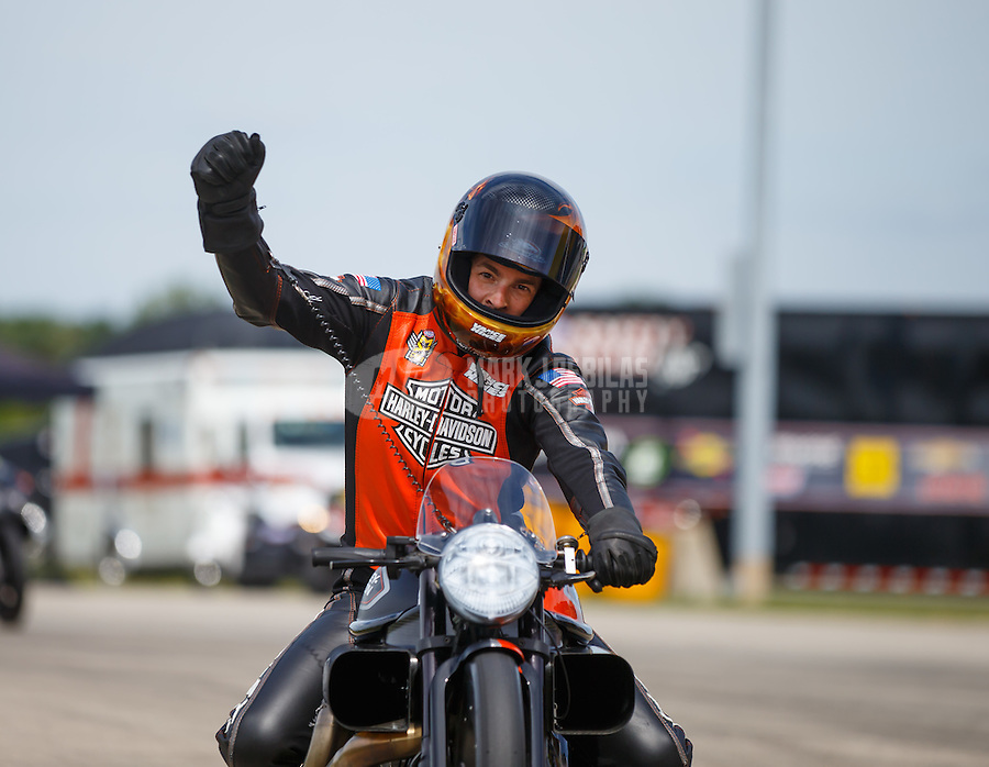 Jul 10, 2016; Joliet, IL, USA; NHRA pro stock motorcycle rider Andrew Hines celebrates after winning the Route 66 Nationals at Route 66 Raceway. Mandatory Credit: Mark J. Rebilas-USA TODAY Sports