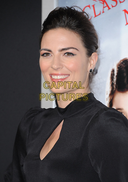 Monique Ganderton.attending the Paramount Los Angeles film premiere of 'Hansel and Gretel: Witch Hunters', held at The Grauman's Chinese Theater in Hollywood, California, USA, January 24th 2013..portrait headshot hair up  black cut out  high neck                                         .CAP/DVS.©Debbie VanStory/Capital Pictures.