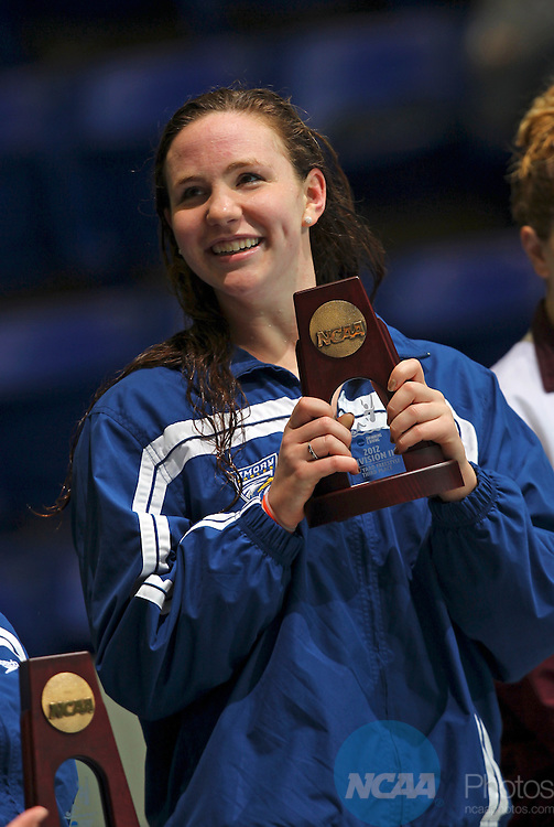 24 MAR 2012:  Third place finisher in the 100 yard freestyle Anna Dobben of Emory holds up her trophy during the Division III Mens and Womens Swimming and Diving Championship held at the IU Natatorium in Indianapolis, IN.  Michael Hickey/NCAA Photos