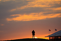 Spectator at sunrise during the Friday Fourballs at the Ryder Cup, Le Golf National, Paris, France. 27/09/2018.<br /> Picture Phil Inglis / Golffile.ie<br /> <br /> All photo usage must carry mandatory copyright credit (© Golffile | Phil Inglis)