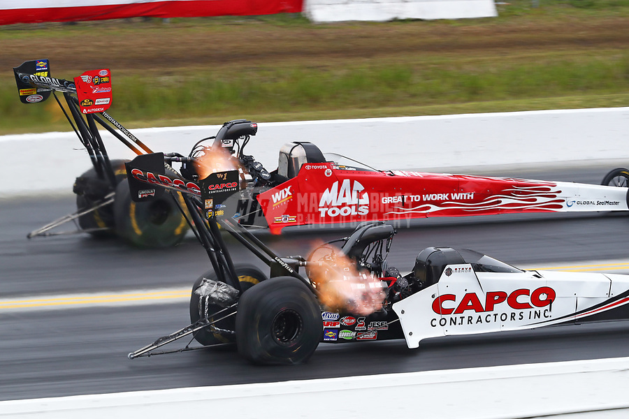 Mar 17, 2019; Gainesville, FL, USA; NHRA top fuel driver Doug Kalitta (far) defeats Steve Torrence during the Gatornationals at Gainesville Raceway. Mandatory Credit: Mark J. Rebilas-USA TODAY Sports