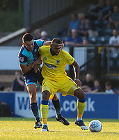 Luke O'Nien of Wycombe Wanderers and Liam Trotter of AFC Wimbledon during the Friendly match between Wycombe Wanderers and AFC Wimbledon at Adams Park, High Wycombe, England on 25 July 2017. Photo by Andy Rowland.