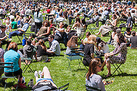 Crowds of visitors pack the lawn at Bryant Park in New York enjoying the 70 degree warm weather and a break from the rain on Thursday, May 12, 2016. While the warm weather continues the next couple of days may see showers. (© Richard B. Levine)