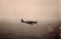 BNPS.co.uk (01202 558833)<br /> Pic: Bosleys/BNPS<br /> <br /> Field took a picture of his RAF Mustang fighter escort's as they sped across the North sea towards Norway at low altitude.<br /> <br /> Archive of heroic survivor of 'Very Enjoyable' Black Friday raid in which 14 of his squadron died has been revealed.<br /> <br /> A stoic British pilot who survived a disastrous World War Two operation that became known as 'Black Friday' wrote in his logbook 'very enjoyable' afterwards. <br /> <br /> Flying Officer Robert Field's Bristol Beaufighter bomber escaped unscathed from the unsuccessful RAF attack on German shipping sheltering in a Norwegian fjord in February 1945.<br /> <br /> Ten RAF planes were destroyed in the sortie resulting in the deaths of 14 crew. Four more were taken Prisoner of War having baled out. <br /> <br /> His logbook has now been made available for sale at Bosleys auctionners for &pound;400.
