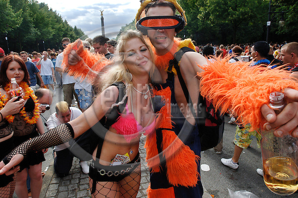 "BERLIN - GERMANY 15. JULY 2006 -- Ravers dance during the 'Love Parade' on the 'Straße des 17. Juni' in front of the 'Siegessaeule' in Berlin, Saturday, 15 July 2006. Under the motto 'The Love is Back' hundreds of thousand ravers celebrated in Berlin's city centre.  -- PHOTO: GORM K. GAARE / EUP- IMAGES..This image is delivered according to terms set out in ""Terms - Prices & Terms"". (Please see www.eup-images.com for more details)"