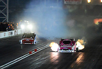 Oct. 26, 2012; Las Vegas, NV, USA: NHRA funny car driver Courtney Force (right) races alongside Bob Tasca III during qualifying for the Big O Tires Nationals at The Strip in Las Vegas. Mandatory Credit: Mark J. Rebilas-