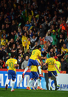 Brazil players celebrate Andreas Pereira's equaliser during the FIFA Under-20 Football World Cup Final between Brazil (gold) and Serbia at North Harbour Stadium, Albany, New Zealand on Saturday, 20 June 2015. Photo: Dave Lintott / lintottphoto.co.nz