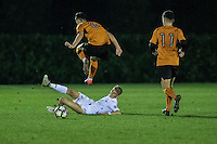Friday  16 December 2014<br /> Pictured:  Christian Herc  Wolverhampton Wonderers jumps high for the ball <br /> Re: Swansea City U18s v Wolverhampton Wonderers U18s, 3rd Round FA youth Cup Match at the Landore Training Facility, Swansea, Wales, UK