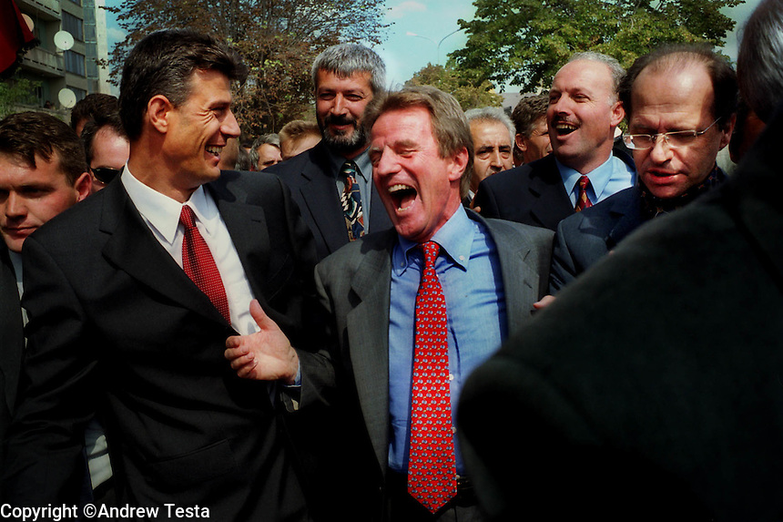 KOSOVO. Pristina. 09/09/2000..Bernard Kouchner shares a joke with Hasim Thaci as he walks at the head of a March Against Violence through Pristina. Ibrahim Rugova is next to Kouchner on the right..©Andrew Testa