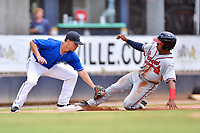 Asheville Tourists third baseman Jeff Moberg (3) fields the throw as Justin Dean (14) slides safely into third during a game against the Rome Braves at McCormick Field on September 3, 2018 in Asheville, North Carolina. The Tourists defeated the Braves 5-4. (Tony Farlow/Four Seam Images)