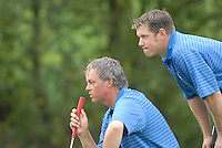 Ryder Cup 206 K Club, Straffin, Ireland...European Ryder Cup team players Darren Clarke and Lee Westwood on the green of the 4th hole during  the  morning fourballs session of the second day of the 2006 Ryder Cup at the K Club in Straffan, Co Kildare, in the Republic of Ireland, 23 September 2006...Photo: Eoin Clarke/ Newsfile.