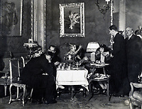 BNPS.co.uk (01202 558833)<br /> Pic: BlenheimPalace/BNPS<br /> <br /> A snapshot of one of the house parties at Blenheim in the 1920's. (Host Gladys Deacon is sat under her portrait)<br /> <br /> Let's Misbehave - A fascinating insight into the heady world of the upper classes in the roaring twenties has opened at Blenheim Palace.<br /> <br /> The 9th Duke of Marlborough and his second wife, American intellectual Gladys Deacon, were lavish hosts at the baroque Oxfordshire Palace.<br /> <br /> Their frequent house parties in a time of great social, artistic and political change were attended by friends as diverse as Winston Churchill, Edith Sitwell, Jacob Epstein and Bloomsbury set founders Lytton Strachey and Virginia Woolf.<br /> <br /> The exhibition showcases their lavish lifestyles in a series of scenes within the Palaces elegant State Rooms.<br /> <br /> Actors portraying the leading characters interact with the visiting public to give a flavour of the famously decadent decade.