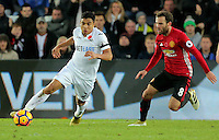 (L-R) Jefferson Montero of Swansea City chased by Juan Mata of Manchester City during the Premier League match between Swansea City and Manchester United at The Liberty Stadium, Swansea, Wales, UK. Sunday 06 November 2016