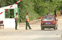 01-AUG-02: NORTH KOREAN BORDER: TUMEN, JILIN, CHINA<br /> South Koreans look at North Korea from the Chinese border town of Tumen. Thousands of South Korean tourists visit the border area daily. China and North Korea are seperated by the Tumen River.