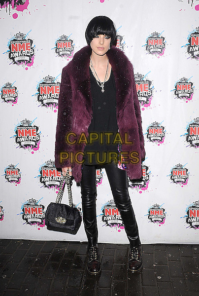 AGYNESS DEYN.The Shockwaves NME Awards 2010 held at Brixton Academy, London, England..February 24th, 2010.full length black leather trousers top purple pink fur jacket bag purse.CAP/BEL.©Tom Belcher/Capital Pictures.