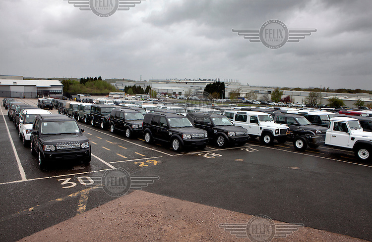 Newly built Range Rovers and Land Rovers parked up while awaiting transportation at the Land Rover plant in Solihull.