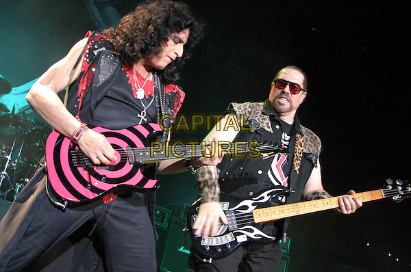 TWISTED SISTER.Twisted Sister Live at Nottingham Arena..UK, United Kingdom..16th November2005..Ref: JEZ.half length performing on stage singing live music gig concert playing pink electric guitar guitarist bass player.www.capitalpictures.com.sales@capitalpictures.com.©Capital Pictures