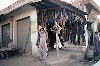 The owner of one of the many gun shops at Darra, in the tribal areas near the Khyber Pass, stands proudly in front of his premises. Outside are mainly pistols but inside is a wide ranging stock of knock-off but fully functional weapons.