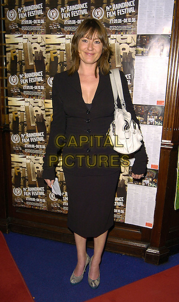 "HOLLY AIRD .At The ""Scenes Of A Sexual Nature"" World Premiere,.London, England, October 8th 2006..full length black dress.Ref: CAN.www.capitalpictures.com.sales@capitalpictures.com.©Can Nguyen/Capital Pictures"