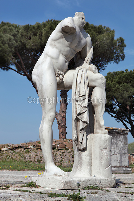 Naked, resting male person, portrait statue of C. Cartilius Poplicola, one of the leading figures in Ostia in the first century BC, Tempio di Ercole (Temple of Hercules), 1st century BC, Ostia Antica, Italy. Picture by Manuel Cohen